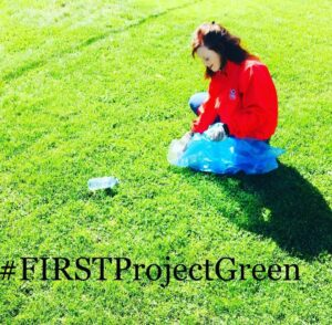 FIRST Project Green A girl sitting on a lawn