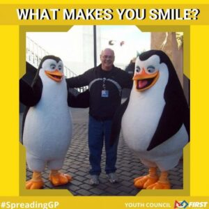 Man in between two penguins, what makes you smile