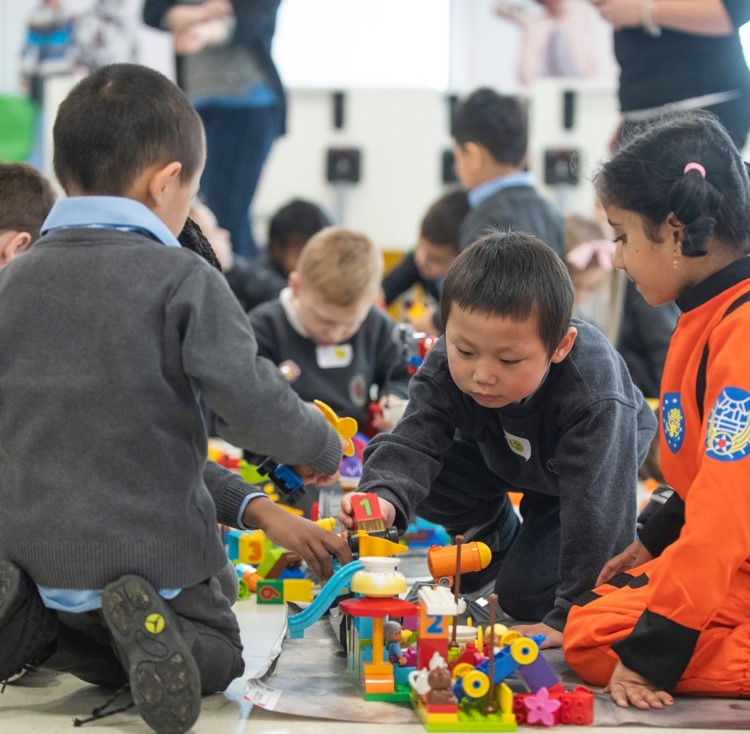 Young Kids Playing with LEGO